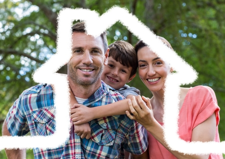 Digital composition of family standing outdoors against house outline in background Stock Photo