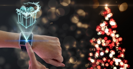Digital composition of woman using smart watch against bokeh background