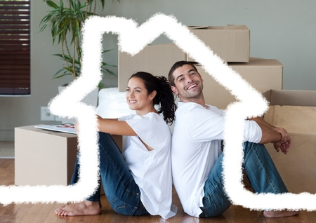 Digital composition of couple sitting in living room against house outline in background photo