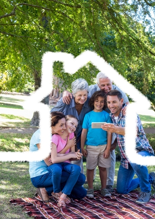 handholding: Digital composition of multigeneration family taking a selfie outdoor against house outline in background