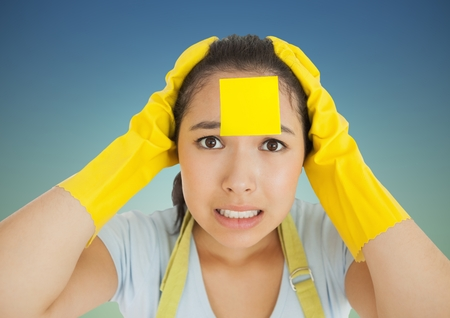 yellow notepad: Portrait of stressed woman in rubber gloves with blank sticky note on her forehead