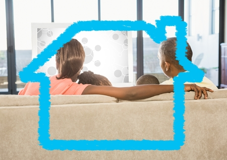 Rear-view of family sitting on sofa at home against home outline in background photo