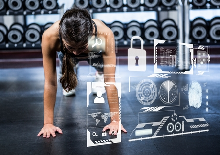 digital composite: Digital composition of woman doing push up exercise in gym and fitness interface