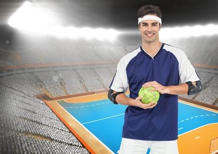 terrain de handball: Digital composition of handball player holding ball in stadium Banque d'images