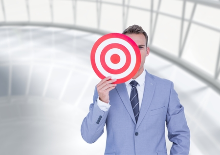 classy house: Businessman holding a target in front of his face Stock Photo