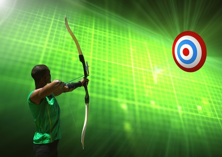 Digital composition of man aiming with bow and arrow at target against green background Stock Photo