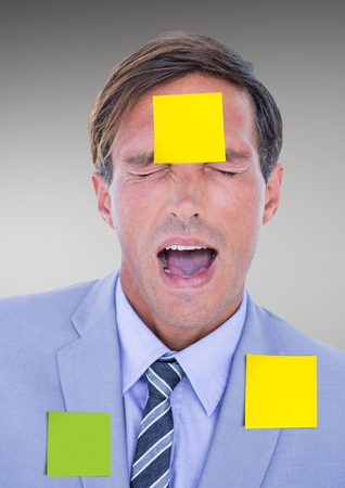 Businessman with blank sticky notes stuck on his face against grey background