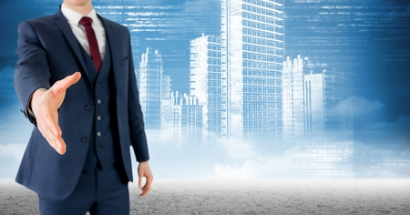 Digital composition of businessman offering hand for handshake with skyscrapers in background Stock Photo