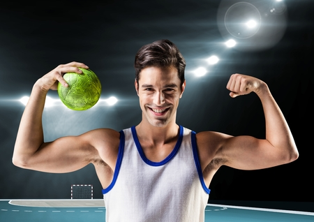 Digital composition of happy man holding handball and flexing muscles Stock Photo