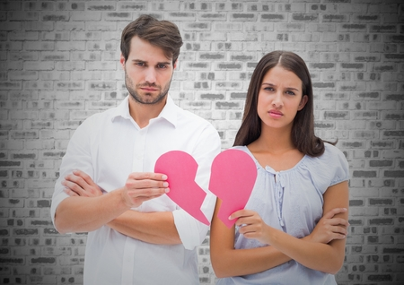 strife: Portrait of worried couple holding a broken heart