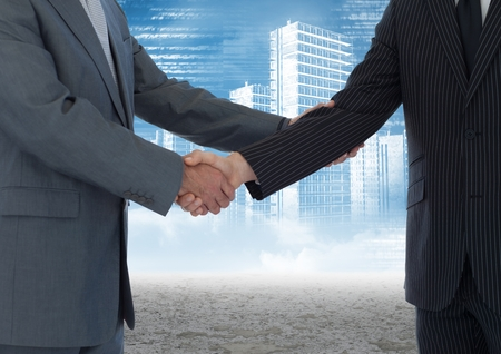Digital composite image of business professionals shaking hands against cityscape in background photo