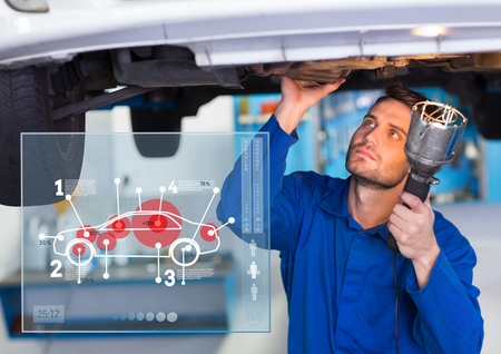 handholding: Digital composition of automobile mechanic working in garage and mechanic interface