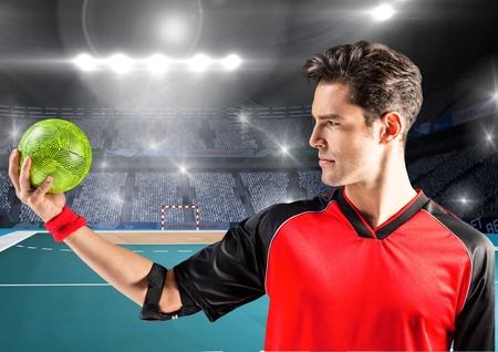 elbow band: Digital composition of man holding handball at handball court Stock Photo
