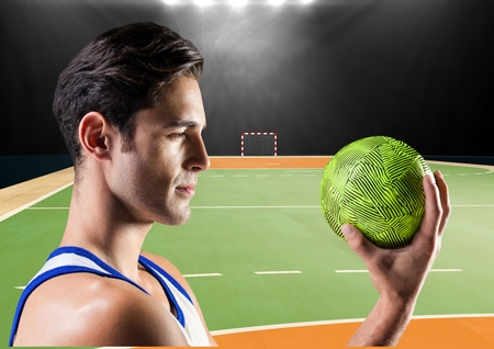 Digital composition of player holding a handball in stadium