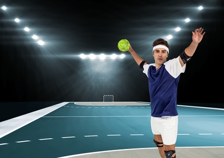Portrait of player playing handball in stadium Stock Photo