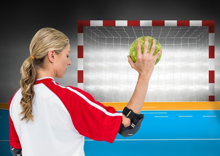 Digital composite image of female athlete throwing handball against goal post in background