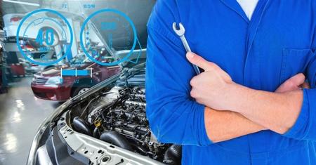 lug: Digital generated image of mechanic holding lug wrench in car repair garage Stock Photo