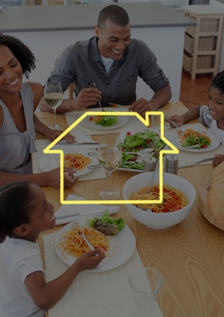 Digital composition of home outline with family having food on dining table photo