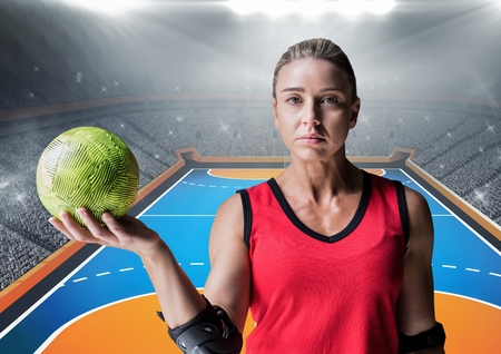 Portrait of determined player holding a handball in stadium