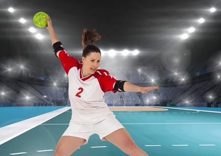 Determined player playing handball in stadium