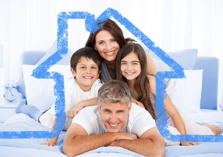 abode: Digital composite image of family on bed together with house outline Stock Photo