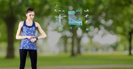 Digital generated image of fit woman using smart watch with futuristic interface