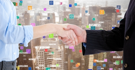 Digital composition of business executives shaking hands against cityscape in background