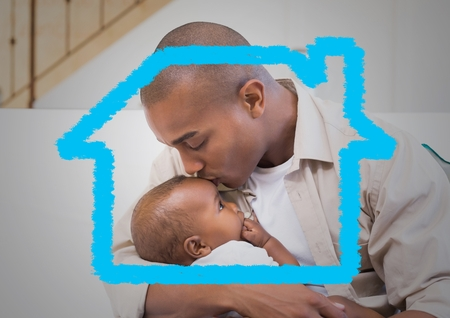 Affectionate father kissing his son on forehead with digitally generated house outline