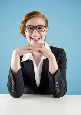 phoning: Smiling businesswoman on desk against blue background