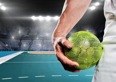Close up of player holding a handball in stadium