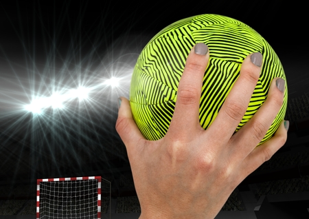 night out: Close up of hand holding a handball in stadium