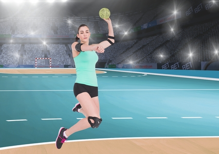 Digital composition of player playing handball in stadium