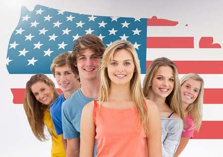 Portrait of friends standing together against american flag in background