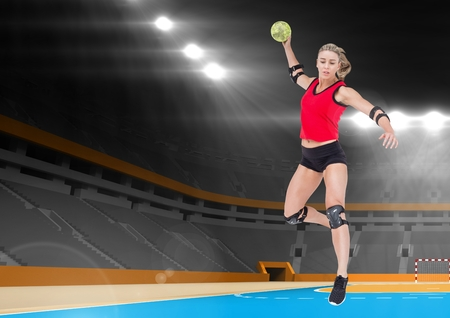 Digital composite image of female athlete playing handball in stadium Stock Photo