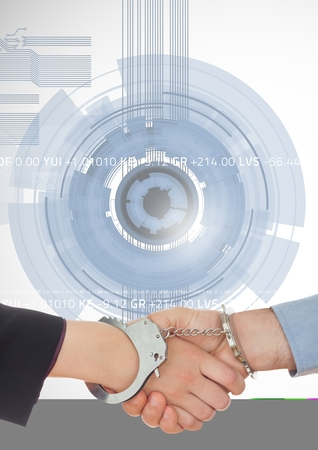 trapped: Digital composite image of business professionals shaking hands with handcuff against technology background Stock Photo