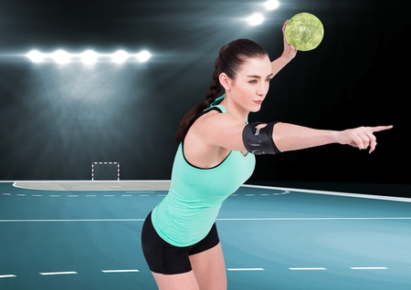 Digital composite image of female athlete throwing handball against stadium in background