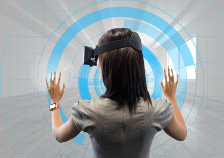 Digital generated image of female executive wearing virtual reality headset with futuristic interface Stock Photo