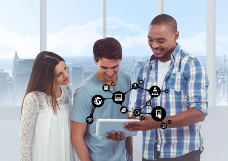 Digitally generated image of executives using digital tablet against with connecting icons photo