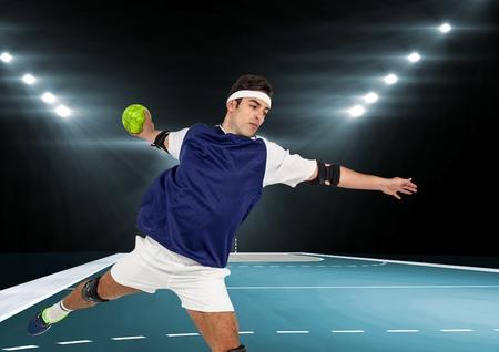 Digital composite image of male athlete playing handball in stadium