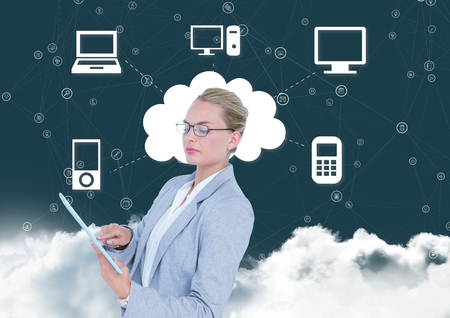 smother: Digital composition of businesswoman using digital tablet with networking icons in background Stock Photo