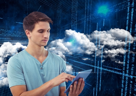 Man using digital tablet against digitally generated background photo