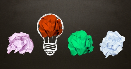 scrolling: Conceptual image of bulb with multi colored crumpled paper on black background