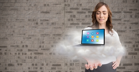 tablet pc in hand: Digital composition of woman holding cloud and laptop with various application icons