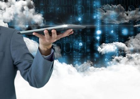 Businessman holding digital tablet against digitally generated background