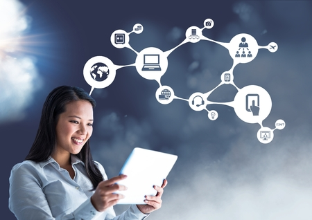 smolder: Digital composite of smiling businesswoman using digital tablet against connecting icons Stock Photo