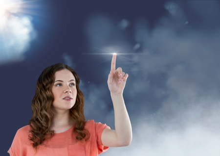 smother: Digital composition of woman touching a flare against sky in background