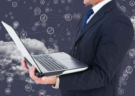 tablet pc in hand: Digital composition of businessman holding laptop with connecting icons and cloud in background