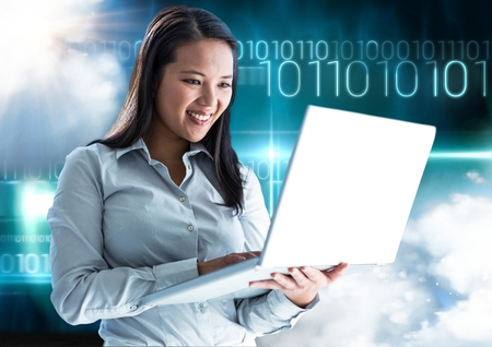 smolder: Digital composition of woman using laptop with binary codes in background