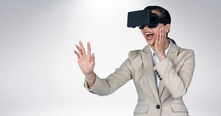 smolder: Woman using virtual reality headset against grey background