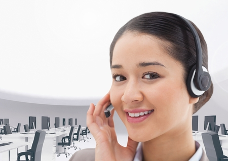 Digital composition of a smiling businesswoman talking on headset in office